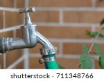 metal water tap with a green... | Shutterstock . vector #711348766