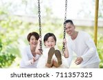 young happy asian family... | Shutterstock . vector #711357325