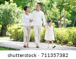 young happy asian family... | Shutterstock . vector #711357382