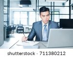 young and successful asian... | Shutterstock . vector #711380212