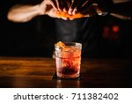 bartender with cocktail and... | Shutterstock . vector #711382402