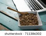 bowl of cereal bran sticks with ... | Shutterstock . vector #711386302