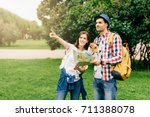 young man traveller with his... | Shutterstock . vector #711388078