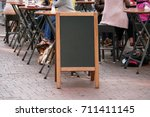 Small photo of blank blackboard advertising sign or customer stopper at sidewalk cafe