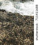 ocean waves and stones... | Shutterstock . vector #711411688