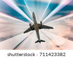big airplane taking up motion... | Shutterstock . vector #711423382