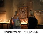 worshippers pause for... | Shutterstock . vector #711428332