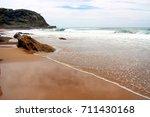 beach on a cloudy day. | Shutterstock . vector #711430168
