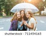 three happy teenager girls with ... | Shutterstock . vector #711454165