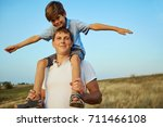 son with father in the open air ... | Shutterstock . vector #711466108