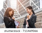 two business women hand raise... | Shutterstock . vector #711469066