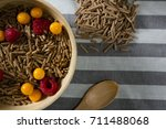 bowl of cereal bran stick with... | Shutterstock . vector #711488068