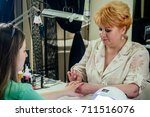woman applies and dries lacquer ... | Shutterstock . vector #711516076