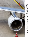 Small photo of Aircraft engine with spinning turbofan