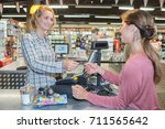 female sales assistant holding... | Shutterstock . vector #711565642