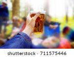 a plastic glass of beer in the...   Shutterstock . vector #711575446