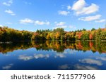 church pond in fall with... | Shutterstock . vector #711577906