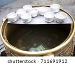Many Silver Small Bowls On The...