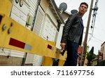 a man with a gun out back... | Shutterstock . vector #711697756