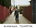a man in a leather jacket and a ... | Shutterstock . vector #711699736
