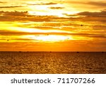 orange sea sun with in horizon... | Shutterstock . vector #711707266