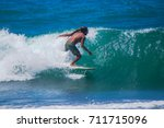 riding the waves. edwin nieves  ... | Shutterstock . vector #711715096
