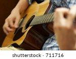 hands playing a guitar | Shutterstock . vector #711716