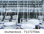 rolls of industrial cotton... | Shutterstock . vector #711727066