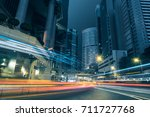 traffic trails in downtown hong ... | Shutterstock . vector #711727768