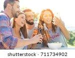group of friends having fun... | Shutterstock . vector #711734902