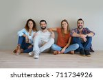 group of friends sitting on... | Shutterstock . vector #711734926