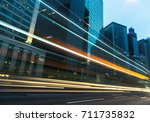 traffic trails in downtown hong ... | Shutterstock . vector #711735832