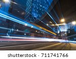 traffic trails in downtown hong ... | Shutterstock . vector #711741766
