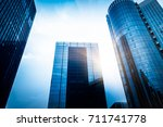 modern skyscrapers against sky... | Shutterstock . vector #711741778