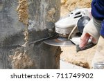 Worker Cutting Concrete Pile...