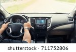 Small photo of Panorama photo young man driving in the modern car from internal view