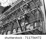 fire escape stairs on building... | Shutterstock . vector #711756472