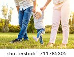 the first steps of the baby.  a ... | Shutterstock . vector #711785305