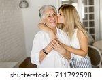 grandmother kissing... | Shutterstock . vector #711792598