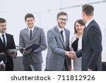 welcome and handshake of... | Shutterstock . vector #711812926