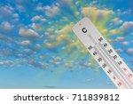 thermometer sun sky 44 degrees. ... | Shutterstock . vector #711839812