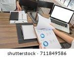 business people working...   Shutterstock . vector #711849586