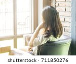 woman with long hair sitting... | Shutterstock . vector #711850276