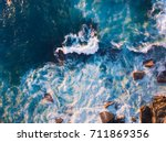 aerial view of waves and some... | Shutterstock . vector #711869356