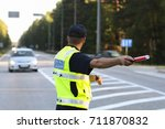latvian police man is directing ... | Shutterstock . vector #711870832