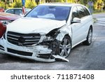 Stock photo front of a car get damaged by crash accident on the road 711871408