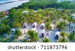 aerial photo of glover's reef... | Shutterstock . vector #711873796