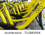 """Small photo of KUALA LUMPUR, MALAYSIA - September 9, 2017 : OFO bicycle close up. Founded in 2014 at China, OFO first in the world to introduce """"non-docking"""" bike sharing platform operated by smartphone application."""
