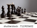 playing wooden chess pieces....   Shutterstock . vector #711905602