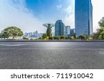 empty road with modern business ... | Shutterstock . vector #711910042